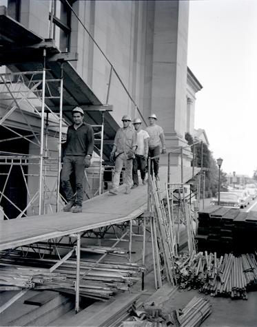 Construction workers repairing the legislative building after it was damaged in an earthquake on April 29, 1965. Legislative building, earthquake damage, exterior, 1965, Susan Parish Photograph Collection, 1889-1990, Washington State Archives, Digital Archives.