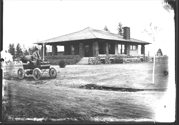 George W. Fox in front of Fox House, Photographs, Spokane City Historic Preservation Office, Washington State Archives, Digital Archives.