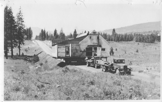 Truck Towing House on Trailer, 1900-1940, unknown photographer, scpa00800001032, Kettle Falls History Center Photographs, Crossroads on the Columbia Collection, Washington State Archives, Digital Archives.