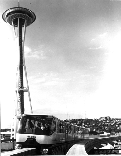 "The Space Needle and the Alweg Monorail were symbols of modernity and ""the Space Age."" Seattle Monorail and the Seattle Space Needle, 1964, General Subjects Photograph Collection, 1845-2005, Washington State Archives, Digital Archives."