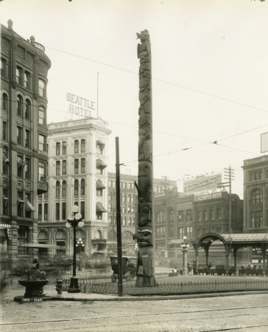 Totem pole, Pioneer Place, Seattle, Photographs, State Library Photograph Collection, 1851-1990 Washington State Archives, Digital Archives.
